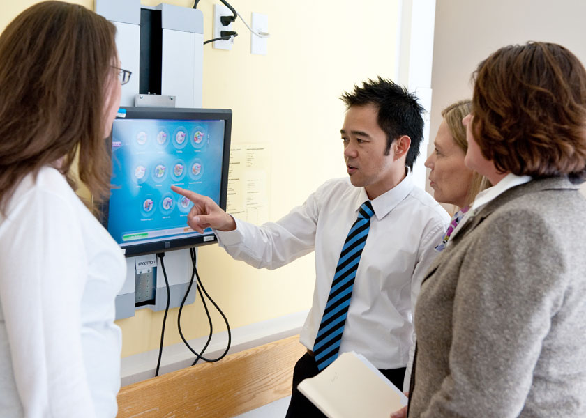 Staff discuss electronic medical records system